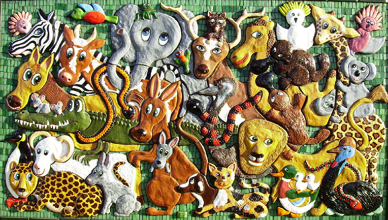Wall based Naive sculpture of many different animals, made from ceramic & mosaic by artist Marie Jonsson-Harrison