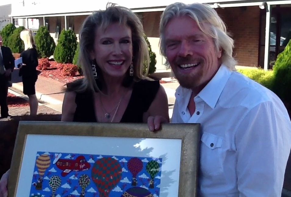 Richard Branson and Australian Naive Artist Marie Jonsson-Harrison with her painting Spot the Virgin