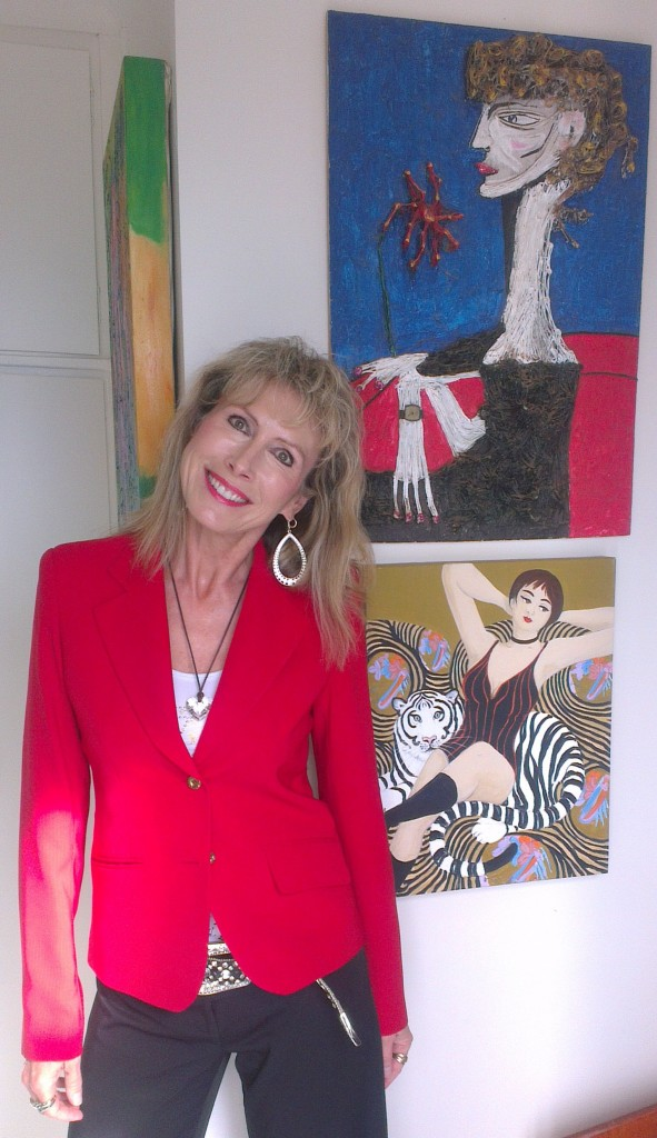 artist marie jonsson harrison dressed in red with artworks by her father ted jonsson and bronwen roodenrys on her way to carols by candlelight