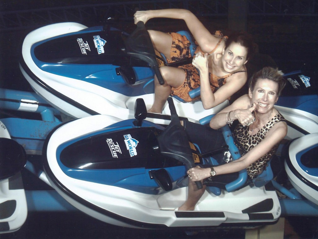photo of naive artist marie jonsson harrison and hillivi harrison enjoying a ride at seaworld