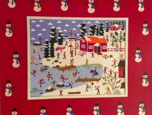 painted snowmen surrounds this Swedish winter scene of red cottages,pine trees and a frozen lake where people ice skate.
